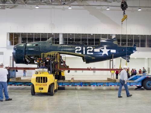 Staff Move Helldiver into Mary Baker Engen Restoration Hangar