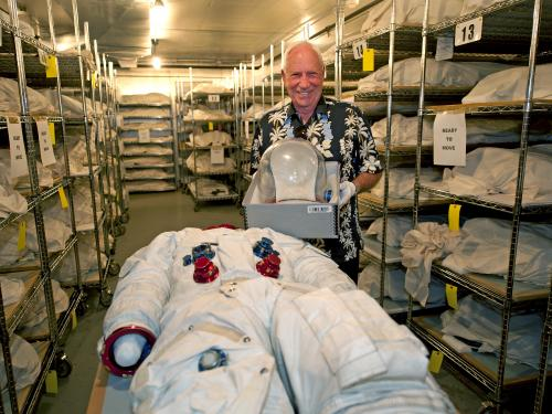 Apollo 15 astronaut Al Worden with his spacesuit
