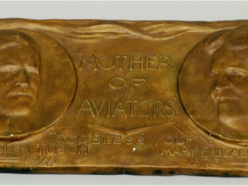 Bronze plaque with image of mother Tusch