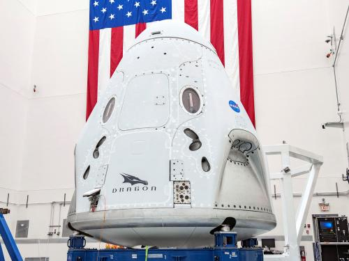 spacecraft in front of American flag
