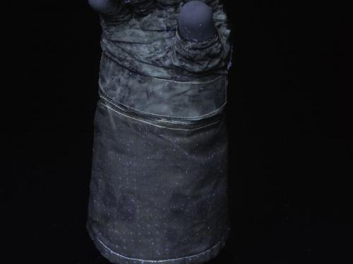 Armstrong's glove glows under UV light.