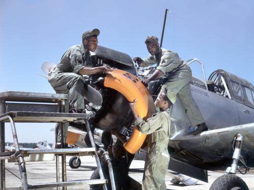 Mechanics at Tuskegee Army Air Field maintain an engine of a Vultee BT-13A Valiant
