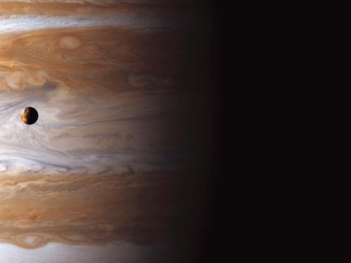 Io High Above Jupiter's Storms