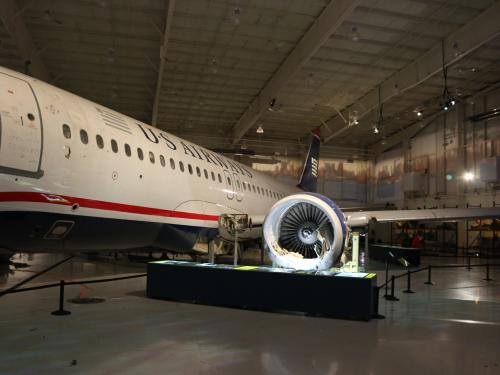 View of the side of the aircraft with an engine clearly visible.