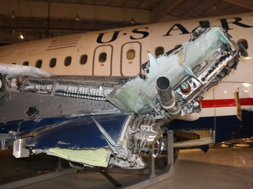 View of a damaged wing where an engine is missing.