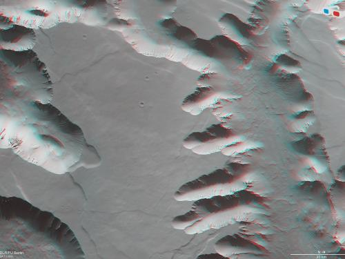 Anaglyph (3-D Image) of Mars' Noctis Labyrinthus, a maze of deep, steep-walled valleys and channels.