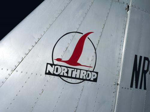 """Northrop"" logo with red bird in circle on tail of metal Northrop Gamma Polar Star aircraft"