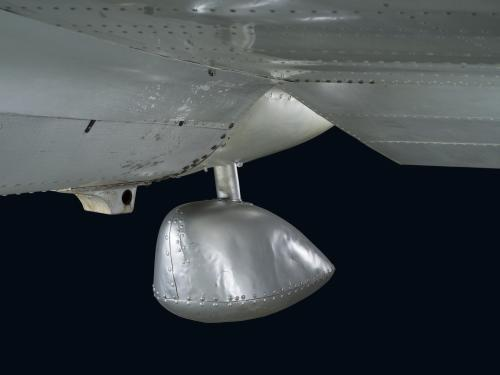 Round bulb-shaped metal rear landing ski on bottom of Northrop Gamma Polar Star aircraft