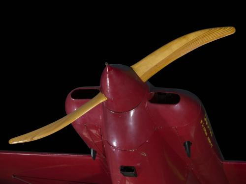 "Wooden single-blade propeller on nose of red Wittman Special 20 ""Buster"" aircraft"
