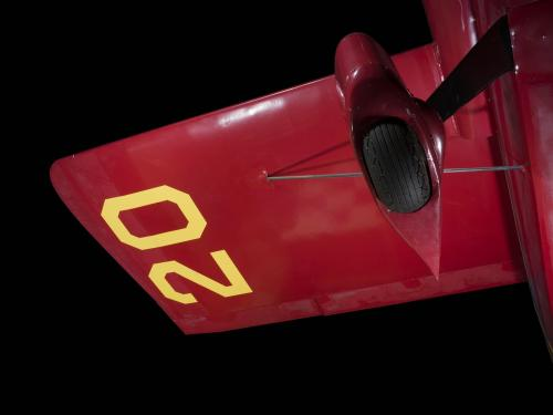 "Yellow ""20"" on underwing and wheel of red Wittman Special 20 ""Buster"" aircraft"