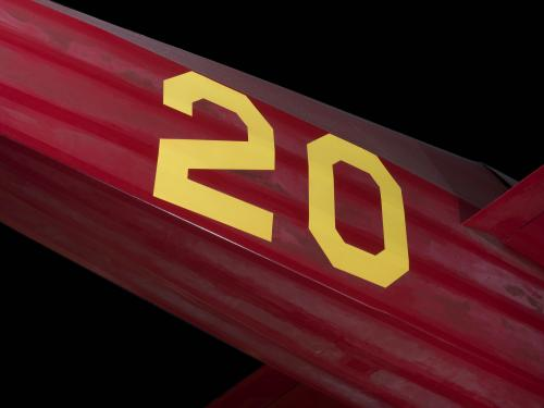 "Yellow ""20"" on body of red Wittman Special 20 ""Buster"" aircraft"