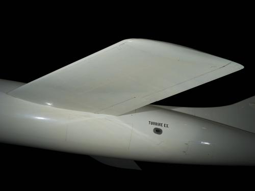 "White flat wing of Douglas D-558-2 aircraft and ""Turbone E.X."" in black letters on body"