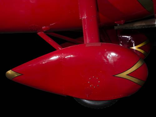 Red teardrop shaped wheel faring on Amelia Earhart Lockheed Vega 5B aircraft