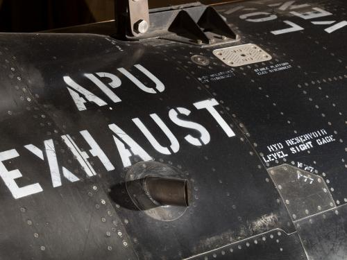 """APU Exhaust"" in white lettering on black titanium North American x-15 aircraft"