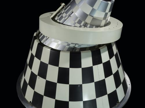 Infrared sensor with black and white checkered cone with a ring mount.