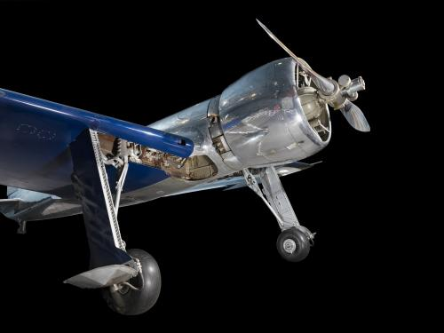 Front of metalic silver and blue Hughes H-1 Racer aircraft with propeller and engine