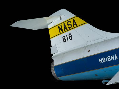 "Tail of Lockheed F-104A Starfighter aircraft with ""NASA"" on yellow stripe in black lettering and ""818"""