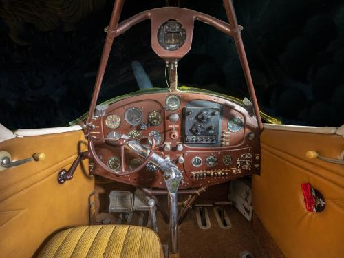 View of the brown instrument panel and yellow leather interiors in the cockpit of the Beechcraft C17L Staggerwing