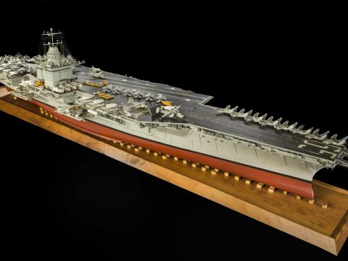 USS Enterprise Aircraft Carrier Model on wooden display stand