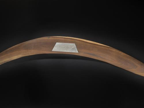 Wooden Apollo 11 Commemorative Boomerang with label on apex