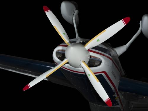 Four-blade propeller of Extra 260 aircraft hanging inverted