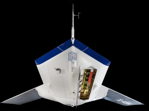 Bottom view of flat white and blue Boeing X-45A with missile bay opened