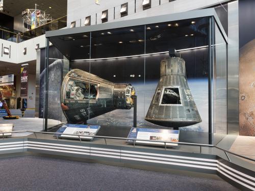 Mercury Friendship 7 and Gemini IV on display in the Boeing Milestones of Flight Hall
