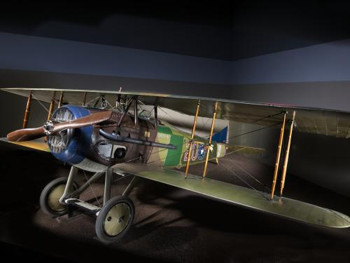 "Green and brown Spad XIII ""Smith IV"" biplane in museum"