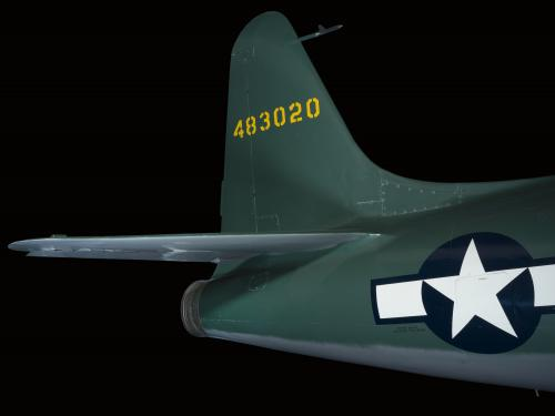 "Tail of green Lockheed XP-80 ""Lulu Belle"" aircraft with United States Air Force insignia on body"