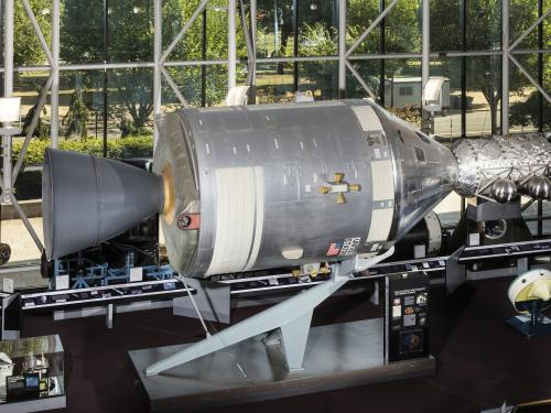 Metal conical command module with cylindrical module in museum