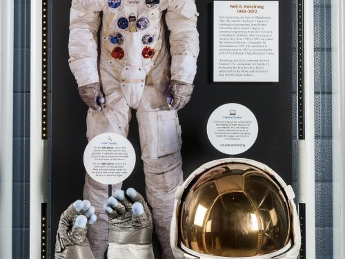 Wide view of Neil Armstrong's Apollo 11 gloves and helmet on display