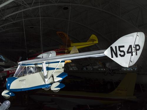 Painted blue and white roadable aircraft hanging in the museum.