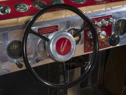 View of a steering wheel connected to an instrument panel on a plane.