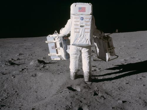 Buzz Aldrin carrying experiments on the surface of the Moon