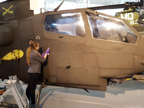 Conservator cleans the surface of a helicopter.