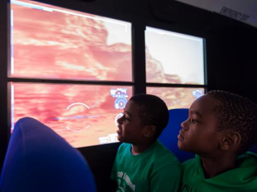 Two students on Mars Experience Bus