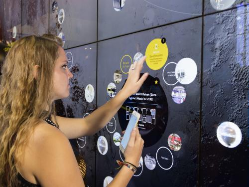 Visitor using the Interactive Wall in the Boeing Milestones of Flight Hall