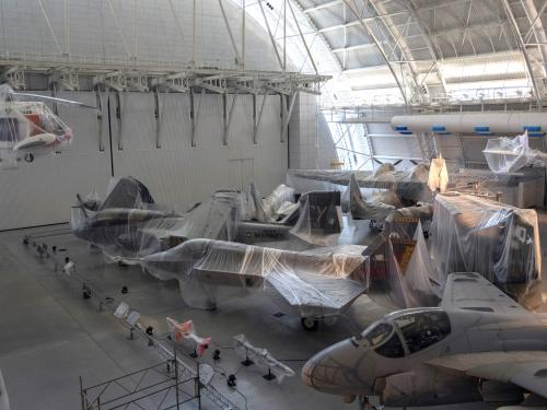 photo of aircraft covered in plastic