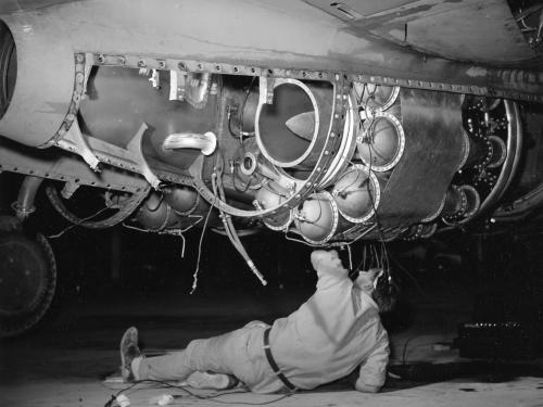 Technician Working on an Airacomet Engine