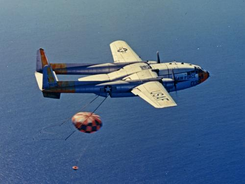 An Air Force C-119 Catching a Returning Capsule in Midair