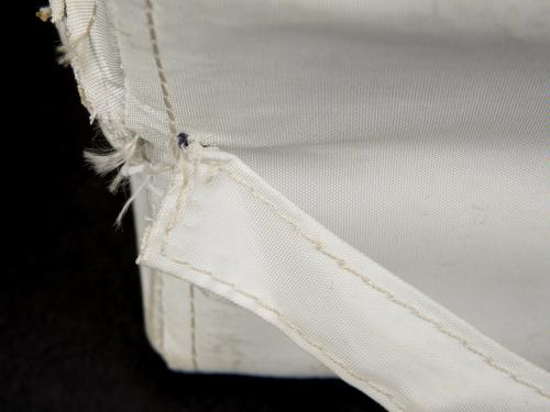 View of the handling strap on the back of the Apollo 11 medical accessory kit before it underwent conservation treatment.