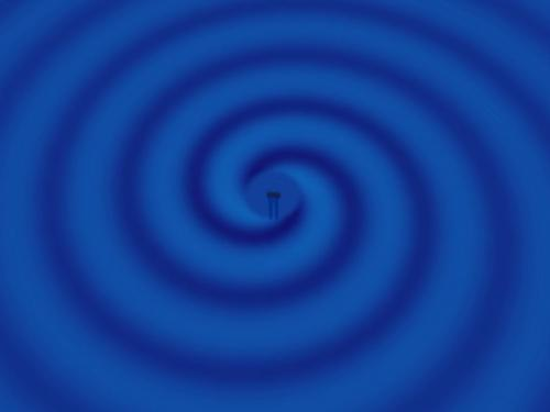 A mathematical animation showing the gravitational waves produced as two black holes spiral toward each other and then collide.