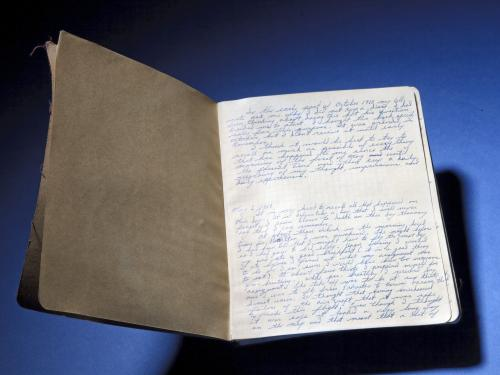 Brown journal opened to first page