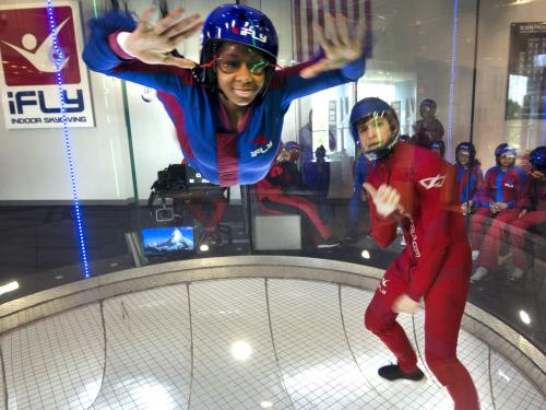 "A student attending the ""She Can"" STEM camp goes indoor skydiving on a field trip to iFly in Ashburn, Virginia."