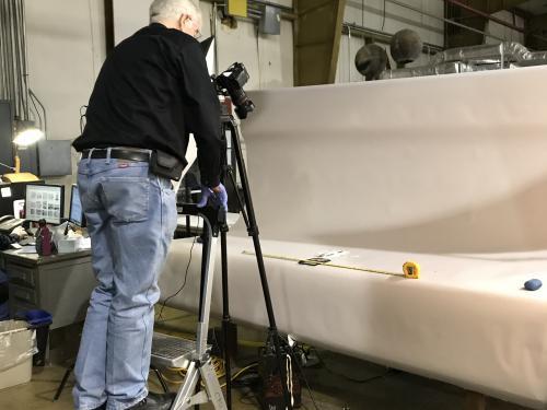 Volunteer Jim Walker takes a high-resolution photograph of a Langley artifact.