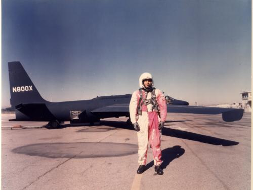 Man in red and white overals in front of U-2