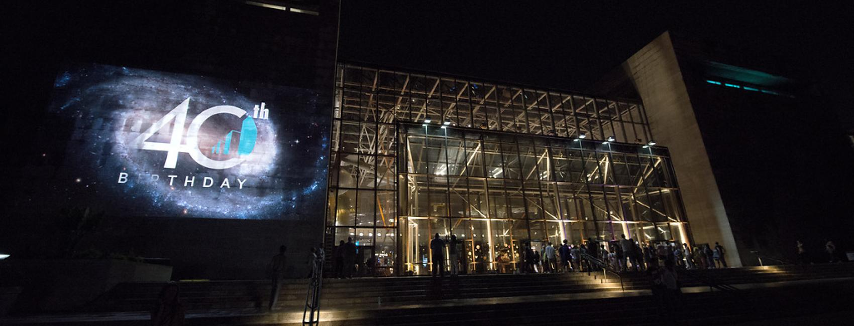 Image of the building with a projection on the exterior.