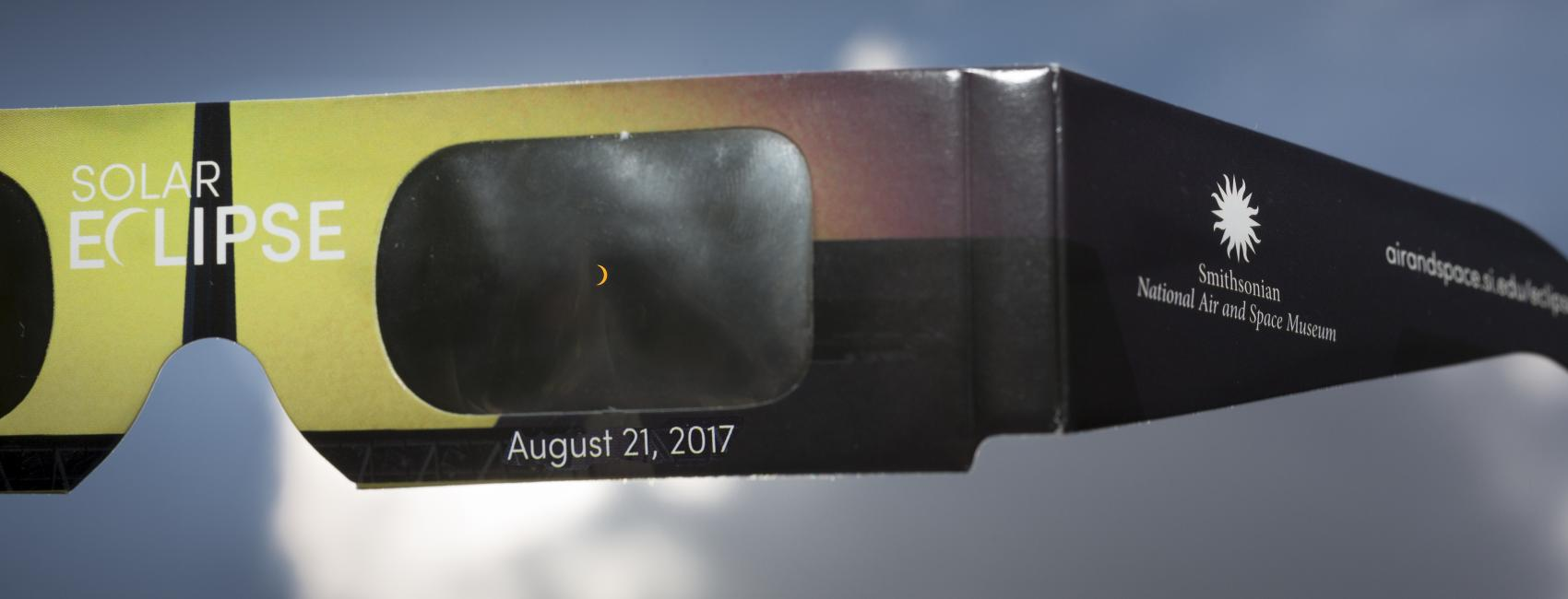 View of a partial eclipse through eclipse viewing glasses