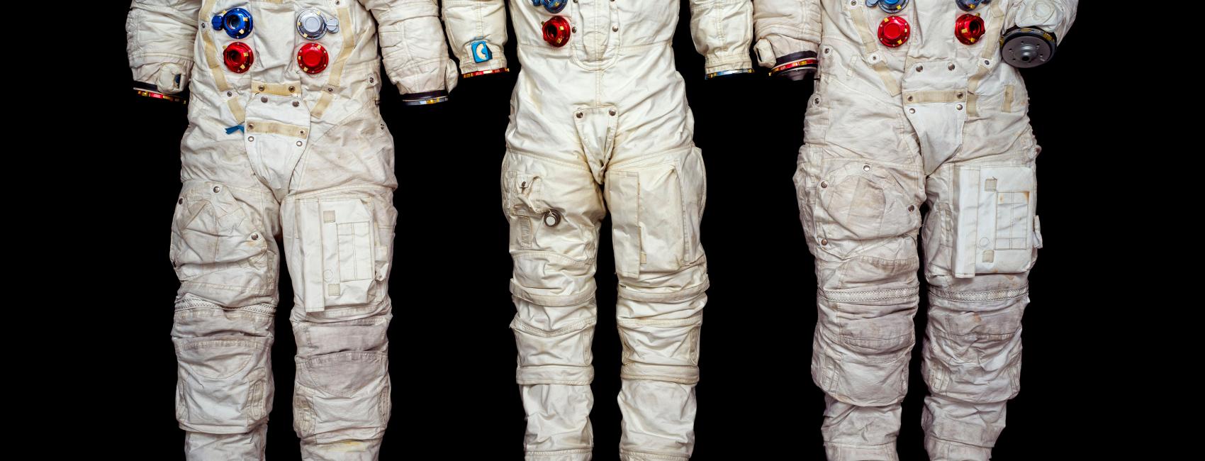 three white Apollo spacesuits