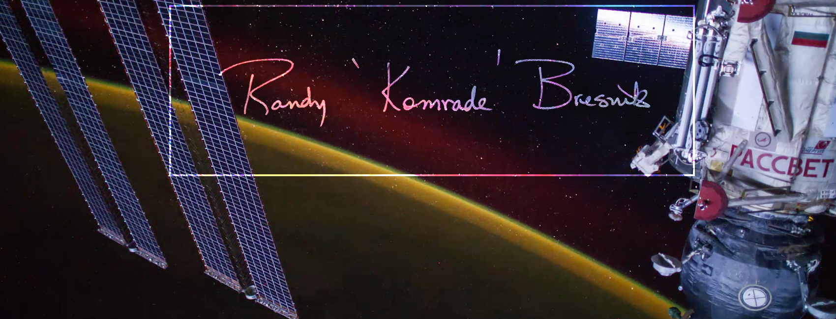 Signature on top of an image of the ISS.